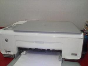 Impresora multifuncional con sistema de tinta contínua.