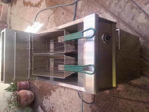 Maquina freidora pollos broaster automatica posot class for Freidora industrial