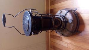 estufa antigua con base de bronce con todos sus accesorios,