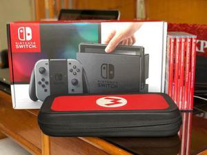 Nintendo Switch + 2 Mandos + Cargador + 5 Juegos + Estuche