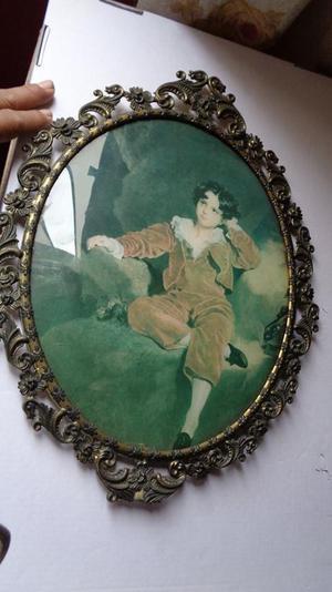 vendo retrato antiguo de metal y vidrio