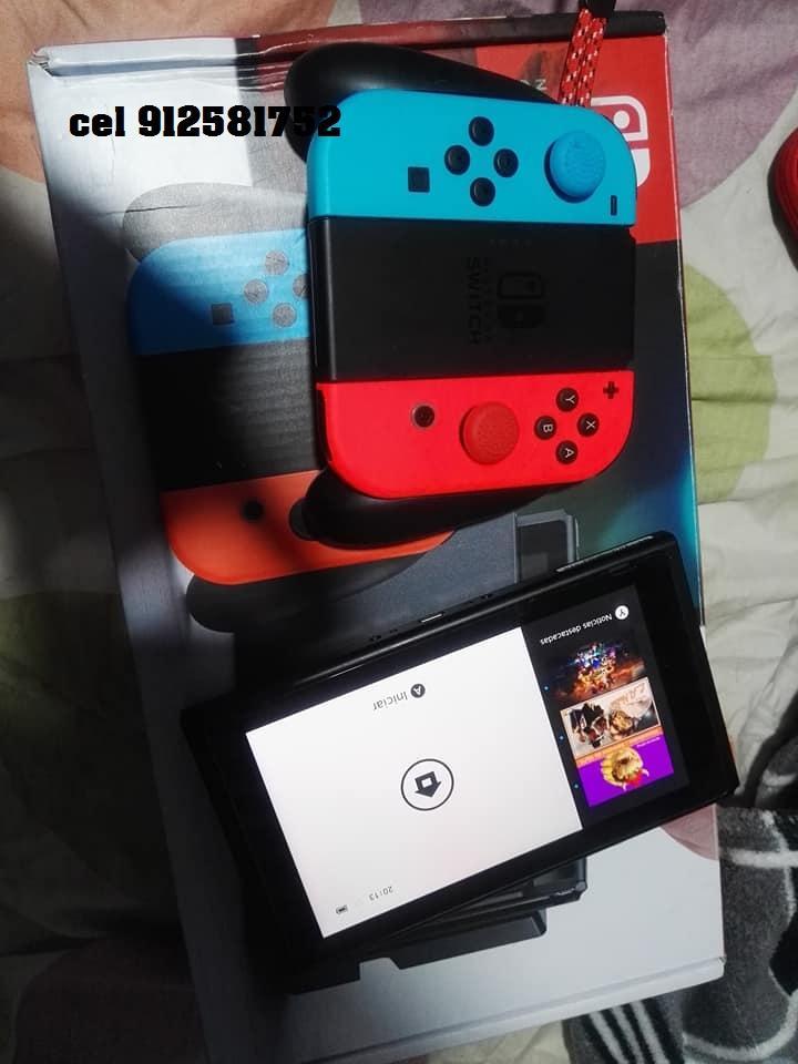 nintendo switch en caja con 4 juegos