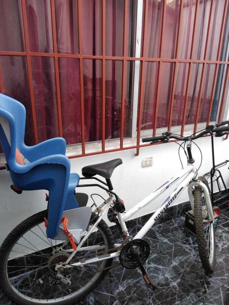 Bicicleta Monarette con asiento para niño/a