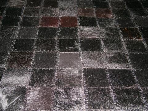 Limpieza de alfombras de cuero de vaca telf. 233-4964