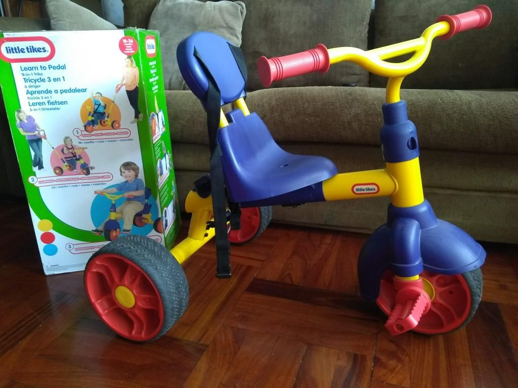 Triciclo Little tikes con guiador casi nuevo